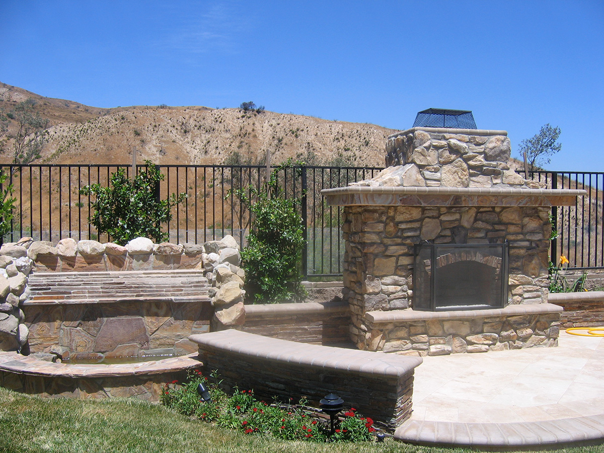 Stacked stone water feature - Natural Boulder Stacked Fireplace Natural Stacked Stone Water Feature Seatwalls W Concrete Cap